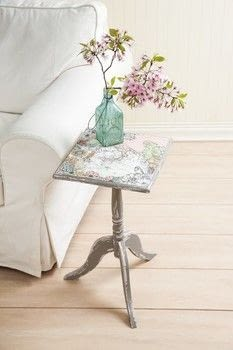 Beginner's Guide to Mod Podge .  Free tutorial with pictures on how to make a side table in under 45 minutes by decorating and decoupaging with decoupage glue, chalk paint, and side table. How To posted by GMC Group.  in the Decorating section Difficulty: Simple. Cost: Cheap. Steps: 6
