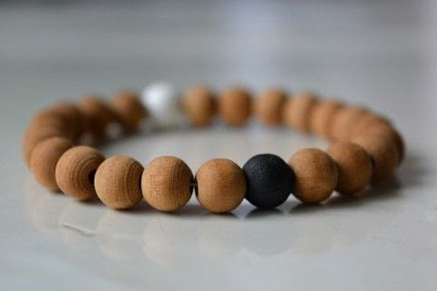 Find the balance in life .  Free tutorial with pictures on how to bead a wooden bead bracelet in under 30 minutes using needle, paint, and elastic thread. How To posted by Silene6.  in the Jewelry section Difficulty: Easy. Cost: Cheap. Steps: 4