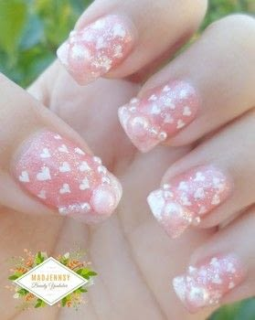 Feeling Romantic? Then show it off through your nails with this tutorial :D .  Free tutorial with pictures on how to paint a glitter nail in under 40 minutes using nail polish. Inspired by hearts. How To posted by Jennifer R.  in the Beauty section Difficulty: Easy. Cost: Cheap. Steps: 1