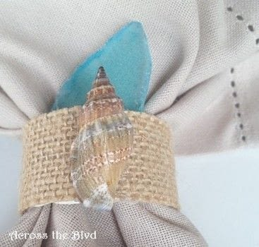 Transform plain napkin rings into Coastal Napkin Rings .  Free tutorial with pictures on how to make a napkin / napkin ring in under 60 minutes using napkin ring, burlap tape, and shell. Inspired by nautical. How To posted by AcrosstheBlvd.  in the Other section Difficulty: Easy. Cost: Cheap. Steps: 7