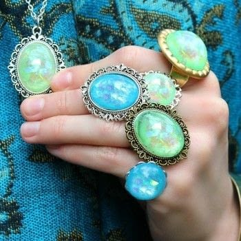 Make beautiful faux opals in every hue for your jewelry projects! .  Free tutorial with pictures on how to make a cabochon ring in 3 steps by resinworking with famowood glaze coat, angel hair easter grass, and nail polish. How To posted by Mark Montano.  in the Jewelry section Difficulty: Easy. Cost: 3/5.