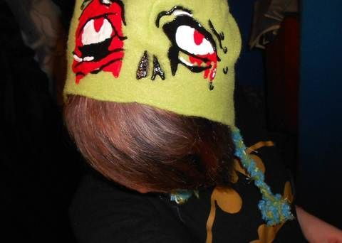 My brain needs more brains!! :) .  Make a character hat in under 180 minutes by decorating with paint brush, fabric paint, and hat. Inspired by halloween, zombies, and gothic. Creation posted by Bloo Rayne. Difficulty: Easy. Cost: Cheap.