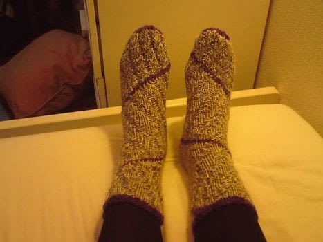 Spiral socks .  Free tutorial with pictures on how to make a sock in 5 steps using knitting yarn, knitting needles, and crochet hook. How To posted by Christine S.  in the Yarncraft section Difficulty: Easy. Cost: Cheap.