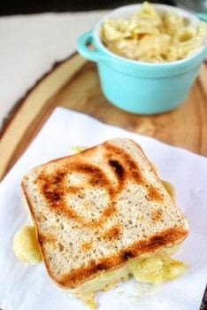 A grilled cheese sandwich filled with macaroni cheese! .  Free tutorial with pictures on how to grill a sandwich in under 25 minutes by cooking with bread, cheese slices, and macaroni. Recipe posted by Cat Morley.  in the Recipes section Difficulty: Simple. Cost: Cheap. Steps: 11