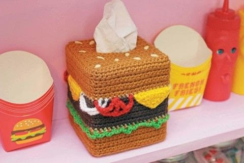 Twinkie Chan's Crocheted Abode a la Mode .  Free tutorial with pictures on how to make a tissues holder in 8 steps by crocheting with worsted weight yarn, crochet hook, and tissue box. Inspired by burgers. How To posted by Creative Publishing international.  in the Yarncraft section Difficulty: Simple. Cost: 3/5.
