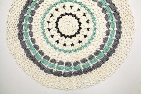 Mandalas to Crochet .  Free tutorial with pictures on how to stitch a knit or crochet rug in 2 steps by crocheting with crochet hook, t-shirt yarn, and yarn needle. How To posted by Search Press.  in the Yarncraft section Difficulty: Simple. Cost: Cheap.