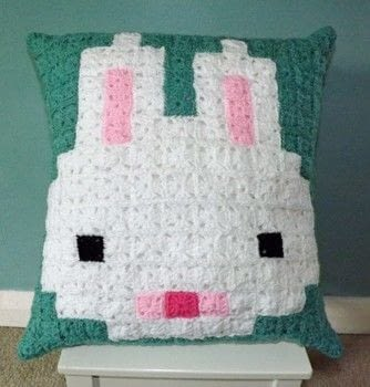 Pixel Bunny .  Make a cushion in under 180 minutes by crocheting with fabric, crochet hook, and cushion inner. Creation posted by PixieFey.  in the Yarncraft section Difficulty: Easy. Cost: Cheap.