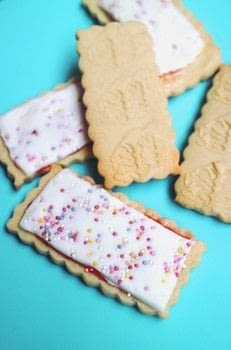 Mini pop tart sugar cookies with jam, icing and sprinkles .  Free tutorial with pictures on how to bake a sugar cookie in under 35 minutes by cooking, baking, and decorating food with rolling pin, butter, and sugar. Inspired by pop tarts. Recipe posted by Cat Morley.  in the Recipes section Difficulty: Simple. Cost: Cheap. Steps: 11