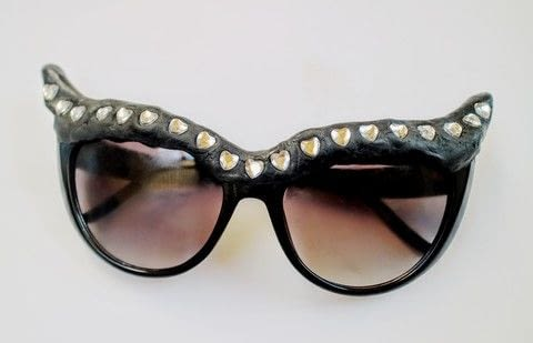Turn an old pair of shades into bejewelled cat eye sunglasses! .  Free tutorial with pictures on how to make a pair of sunglasses in under 25 minutes by molding with sunglasses, crystal clay, and paper. Inspired by cats. How To posted by Cat Morley.  in the Jewelry section Difficulty: Simple. Cost: Cheap. Steps: 6
