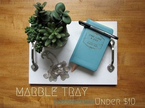 The easiest DIY Marble Tray EVER .  Free tutorial with pictures on how to make a tray in under 20 minutes by decorating with tiles, e6000 glue, and felt pads. Inspired by marble. How To posted by Justine.  in the Home + DIY section Difficulty: Easy. Cost: 3/5. Steps: 3