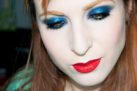 Blue glitter and red lips .  Free tutorial with pictures on how to create a blue eye makeup look in under 10 minutes by applying makeup with lipstick, blush, and dust. Inspired by eyeballs, garbage, and blue. How To posted by Patricia V.  in the Beauty section Difficulty: Simple. Cost: Cheap. Steps: 5