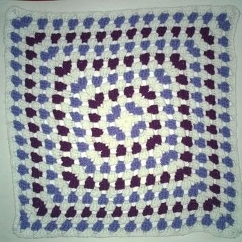 Multi color granny square throw blanket  .  Crochet a granny square blanket using yarn, hook, and yarn. Creation posted by Carol S.  in the Yarncraft section Difficulty: Easy. Cost: 3/5.