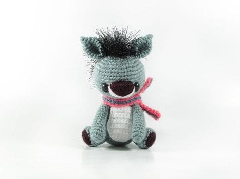 Make the funkiest donkey on the block .  Free tutorial with pictures on how to make a donkey plushie in 12 steps by crocheting and amigurumi with fingering weight yarn, eyelash yarn, and crochet thread. Inspired by donkeys. How To posted by Tales of Twisted Fibers.  in the Yarncraft section Difficulty: Simple. Cost: Absolutley free.