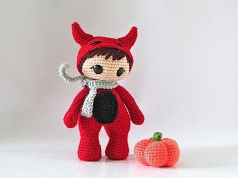 Crochet a little red devil .  Free tutorial with pictures on how to make a devil plushie in 13 steps by crocheting and amigurumi with fingering weight yarn, crochet thread, and crochet hook. Inspired by devils. How To posted by Tales of Twisted Fibers.  in the Yarncraft section Difficulty: Simple. Cost: Absolutley free.