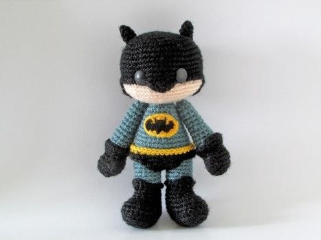 Make your very own amigurumi caped crusader  .  Free tutorial with pictures on how to make a character plushie in 12 steps by crocheting and amigurumi with fingering weight yarn, crochet thread, and crochet hook. Inspired by batman and super hero. How To posted by Tales of Twisted Fibers.  in the Yarncraft section Difficulty: Simple. Cost: Absolutley free.