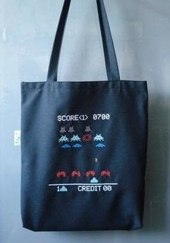 Cross-stitch a stitch invaders tote bag with Urban Cross Stitch .  Free tutorial with pictures on how to make a tote bag in under 120 minutes by cross stitching with canvas, embroidery floss, and embroidery needle. Inspired by space invaders. How To posted by Cut Out + Keep.  in the Needlework section Difficulty: Simple. Cost: Cheap. Steps: 14