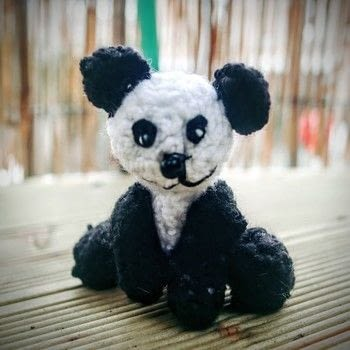 Crochet an amigurumi panda cub .  Free tutorial with pictures on how to make a bear plushie in under 120 minutes by crocheting and amigurumi with yarn, yarn, and crochet hook. Inspired by pandas. How To posted by Cat Morley.  in the Yarncraft section Difficulty: Simple. Cost: Cheap. Steps: 11