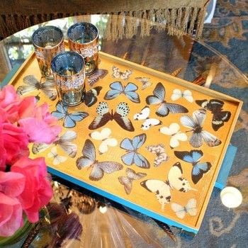 Make a beautiful tray for your home! .  Free tutorial with pictures on how to make a tray in 4 steps by constructing, decorating, embellishing, decoupaging, and resinworking with size, trim, and nails. Inspired by butterflies. How To posted by Mark Montano.  in the Home + DIY section Difficulty: Simple. Cost: 3/5.