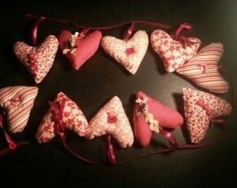 Cute little hearts to brighten a room .  Make bunting in under 120 minutes by sewing and machine sewing with fabric, thread, and  buttons. Inspired by hearts. Creation posted by LoupLou.  in the Sewing section Difficulty: 3/5. Cost: Cheap.