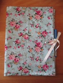 How to sew a fabric folder .  Free tutorial with pictures on how to make a fabric book cover in under 120 minutes using fabric, elastic, and satin ribbon. How To posted by Laura.  in the Sewing section Difficulty: Simple. Cost: Cheap. Steps: 7
