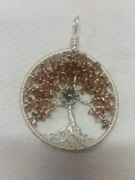 Trees of Life- Wire- Beads-super uno .  Make a wire wrapped pendant in under 120 minutes by wireworking with beads and artistic wire. Inspired by for girlfriends and trees. Creation posted by Kiwigurl.  in the Jewelry section Difficulty: 3/5. Cost: 3/5.