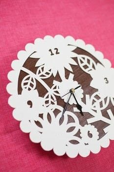 Decorative Paper Craft .  Free tutorial with pictures on how to make a clock in under 180 minutes by papercrafting with templates, scissors, and sticky tape. How To posted by GMC Group.  in the Home + DIY section Difficulty: Simple. Cost: Cheap. Steps: 5