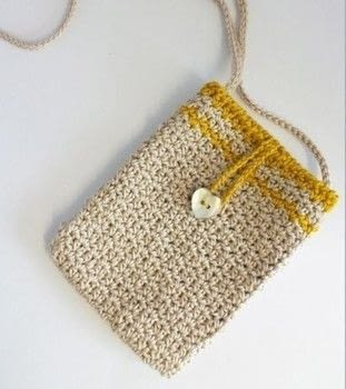 A little beach bag - ready to take for a evening out .  Free tutorial with pictures on how to stitch a knit or crochet bag in 1 step by crocheting with cotton yarn, hook, and buttons. How To posted by Emma V.  in the Yarncraft section Difficulty: Easy. Cost: No cost.