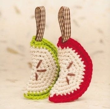 A cute apple keyring .  Free tutorial with pictures on how to stitch a knit or crochet keyring in under 90 minutes by crocheting with cotton yarn, hook, and ribbon. Inspired by apples. How To posted by Emma V.  in the Yarncraft section Difficulty: Easy. Cost: No cost. Steps: 1