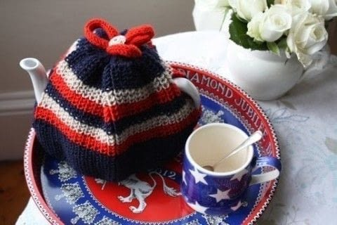 A lovely traditional knitted teacosy .  Free tutorial with pictures on how to make a tea cozy in 1 step by knitting with dk wool, needles, and pom pom maker. How To posted by Emma V.  in the Yarncraft section Difficulty: Simple. Cost: No cost.