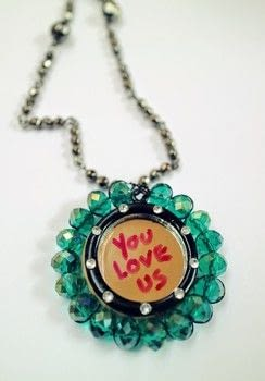 Manic Street Preachers inspired You Love Us mirror necklace! .  Free tutorial with pictures on how to make a pendant necklace in under 25 minutes by jewelrymaking with crystals, pendant, and wooden circle. Inspired by manic street preachers. How To posted by Cat Morley.  in the Jewelry section Difficulty: Simple. Cost: Cheap. Steps: 16