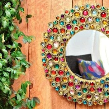 Make a mirror from cardboard! .  Free tutorial with pictures on how to make a wall mirror in 3 steps by spraypainting, decorating, embellishing, papercrafting, Papier-mâchéing, and woodworking with americana decor metallics, clothes pin, and e-6000 glue. How To posted by Mark Montano.  in the Home + DIY section Difficulty: Easy. Cost: Cheap.