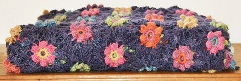 Ermintrude crochet flower blanket .  Stitch a knit or crochet blanket by crocheting with dk wool. Inspired by flowers. Creation posted by queenieamanda.  in the Yarncraft section Difficulty: 3/5. Cost: 3/5.