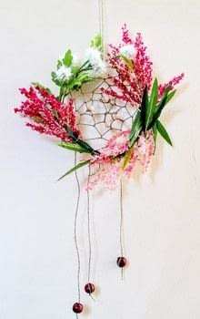 A super easy decoration, perfect for summer! .  Free tutorial with pictures on how to make a floral wreath in under 15 minutes by decorating with hoop, string, and beads. How To posted by Cat Morley.  in the Home + DIY section Difficulty: Simple. Cost: Cheap. Steps: 15