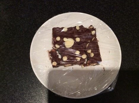 A delicious no-bake treat .  Free tutorial with pictures on how to bake tiffin in under 60 minutes using cocoa powder, biscuits, and dried fruit. Inspired by chocolate and chocolate chip. Recipe posted by Libby W.  in the Recipes section Difficulty: Easy. Cost: 3/5. Steps: 10