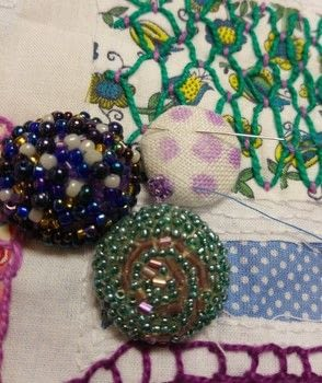 Using a handful of small beads you can transform an ordinary covered button into a thing of great beauty. .  Free tutorial with pictures on how to make a buttons in under 180 minutes using seed beads, beading needle, and matching thread. How To posted by Helen W.  in the Needlework section Difficulty: Simple. Cost: Cheap. Steps: 7