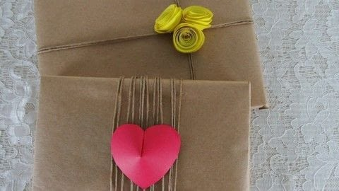 Make these rustic gift wrapping .  Free tutorial with pictures on how to make packaging in under 20 minutes by papercrafting with kraft paper, scissors, and cardstock. Inspired by flowers and hearts. How To posted by bora FAZER.  in the Papercraft section Difficulty: Easy. Cost: Absolutley free. Steps: 1