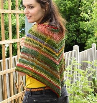 Keep a spring chill at bay with this wild and crazy colour-changing shawl .  Free tutorial with pictures on how to make a shawl in 7 steps by crocheting with crochet hook, tapestry needle, and yarn. How To posted by Woolly Truckle.  in the Yarncraft section Difficulty: Simple. Cost: 3/5.