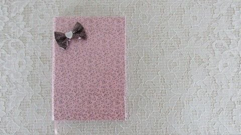 Make waterproof fabric and use it to cover your notebook! .  Free tutorial with pictures on how to make a fabric book cover in under 35 minutes using cotton fabric, notebook, and white glue. Inspired by bows. How To posted by bora FAZER.  in the Home + DIY section Difficulty: Simple. Cost: Cheap. Steps: 1
