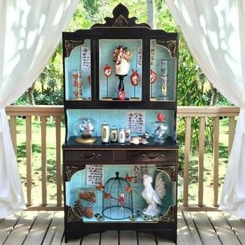 Make a curiosity cabinet .  Free tutorial with pictures on how to make furniture in 4 steps by decorating, embellishing, dyeing, papercrafting, collage, decoupaging, and woodworking with cabinet, americana decor maxx gloss, and book pages. How To posted by Mark Montano.  in the Home + DIY section Difficulty: 3/5. Cost: 3/5.