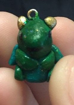 A itty bitty baby Dragon .  Make a charms in under 45 minutes by creating, drawing, constructing, decorating, and embellishing with acrylic paint, polymer clay, and marker pen. Inspired by dragon. Creation posted by Kinhime Dragon.  in the Jewelry section Difficulty: Simple. Cost: No cost.