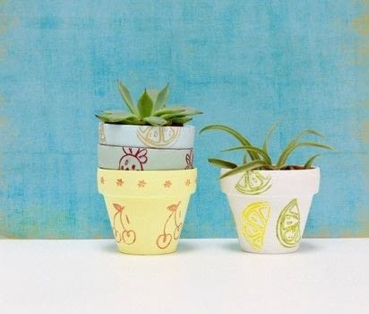 Make these fruity flower pots for your succulents! .  Free tutorial with pictures on how to paint a painted flower pot in 3 steps using paintbrush, acrylic paint, and stampers. Inspired by summer holidays, kids, and fruit. How To posted by Haley  R.  in the Decorating section Difficulty: Simple. Cost: Absolutley free.