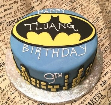 Batman birthday cake .  Bake a layer cake using cake, edible glue, and marshmallow fondant. Creation posted by DeVina D.  in the Recipes section Difficulty: Easy. Cost: Cheap.