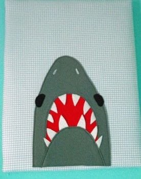 Speedy Fabric Canvas .  Make wall decor in under 60 minutes by machine sewing with canvas, felt, and background. Inspired by sharks. Creation posted by PixieFey.  in the Sewing section Difficulty: Easy. Cost: Absolutley free.