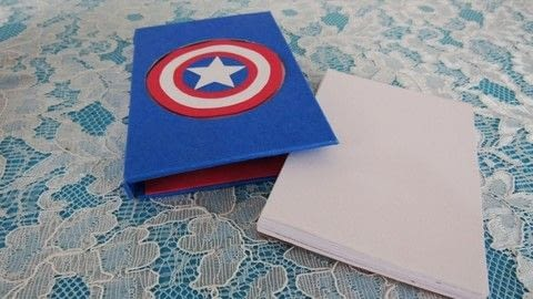 Make Captain America notepad .  Free tutorial with pictures on how to make a piece of paper art in under 30 minutes by paper folding with cardstock, white glue, and foam tape. Inspired by captain america. How To posted by bora FAZER.  in the Papercraft section Difficulty: 3/5. Cost: Absolutley free. Steps: 1