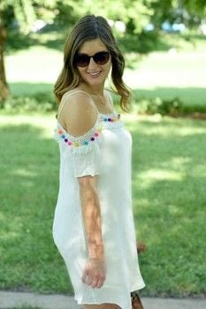 DIY Pom Pom Dress  .  Free tutorial with pictures on how to make an embellished dress in under 60 minutes by not sewing, decorating, and yarncrafting with hot glue gun, dress, and pom pom. How To posted by allthingsgoldk.  in the Home + DIY section Difficulty: Simple. Cost: 3/5. Steps: 4