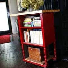 An Antique Radio Stand Converted Into A Red Kitchen Island!