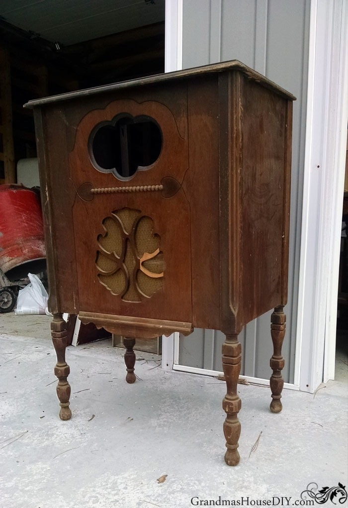 An Antique Radio Stand Converted Into A Red Kitchen Island