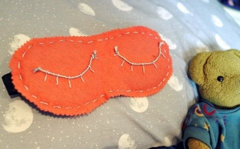Fall asleep with a Karen Mabon inspired eyelash sleeping mask! .  Free tutorial with pictures on how to make a sleeping mask in under 25 minutes by sewing with eye mask, felt, and rope. Inspired by designer. How To posted by Cat Morley.  in the Sewing section Difficulty: Simple. Cost: Cheap. Steps: 12