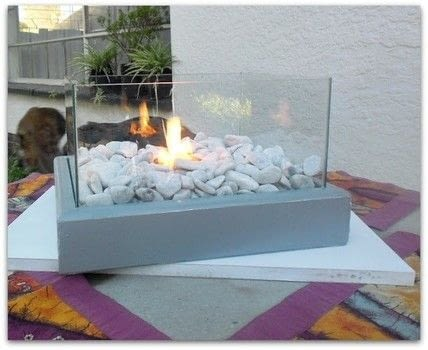 A small DIY Portable Fire Feature which can be used indoors or outdoors .  Free tutorial with pictures on how to make furniture in under 120 minutes by woodworking with wood, wood, and wood. How To posted by Linda @With A Blast.  in the Home + DIY section Difficulty: Simple. Cost: Cheap. Steps: 8