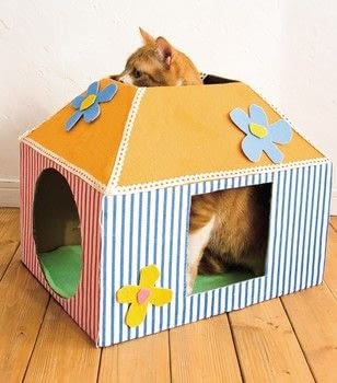 Cattastic Crafts .  Free tutorial with pictures on how to make a pet bed in under 120 minutes by decorating with cardboard box, cardboard, and fabric. Inspired by cats. How To posted by Search Press.  in the Home + DIY section Difficulty: Simple. Cost: Cheap. Steps: 4